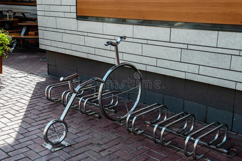 Bicycle Parking. A shiny metal bike is parked in the city Parking lot royalty free stock photo