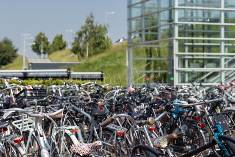 Bicycle parking at train station Barendrecht. A bicycle parking at the train station in Barendrecht, the Netherlands. Bicycles in the foreground and the station stock photos
