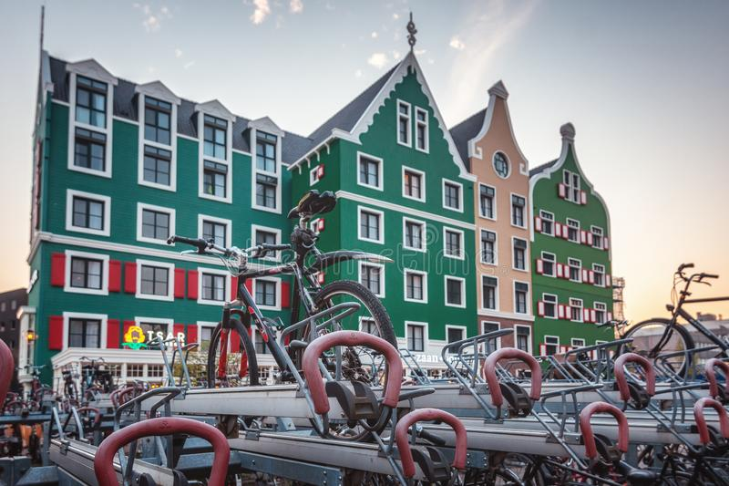 Bicycle parking at Zaandam station with in the background the Zaanhotel in Zaandam built in the typical historical Zaanse building stock photos