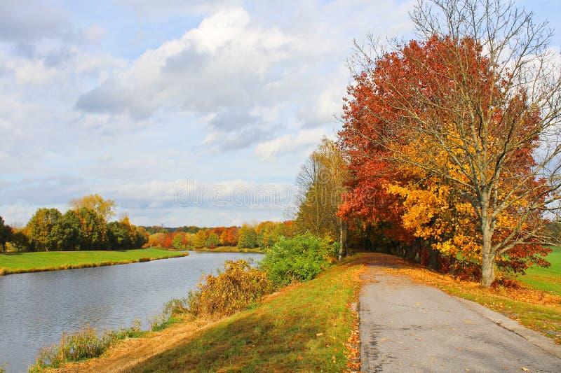 Bicycle path, autumn trees near river Vltava. Czech landscape. Bicycle path, autumn trees near river Vltava. Czech landscape royalty free stock images