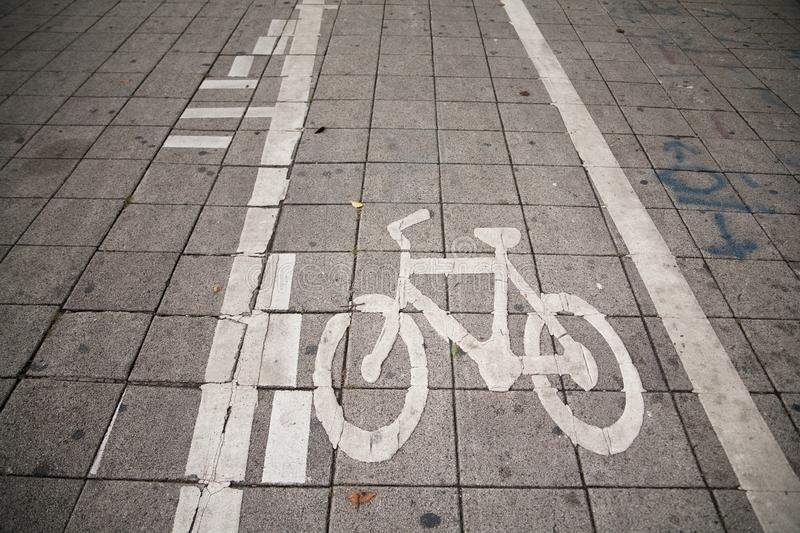 Bicycle path. The bike runs on a sidewalk in the city activities asphalt background bicycle bicycles biking direction environmentally exercise friendly lane royalty free stock photos