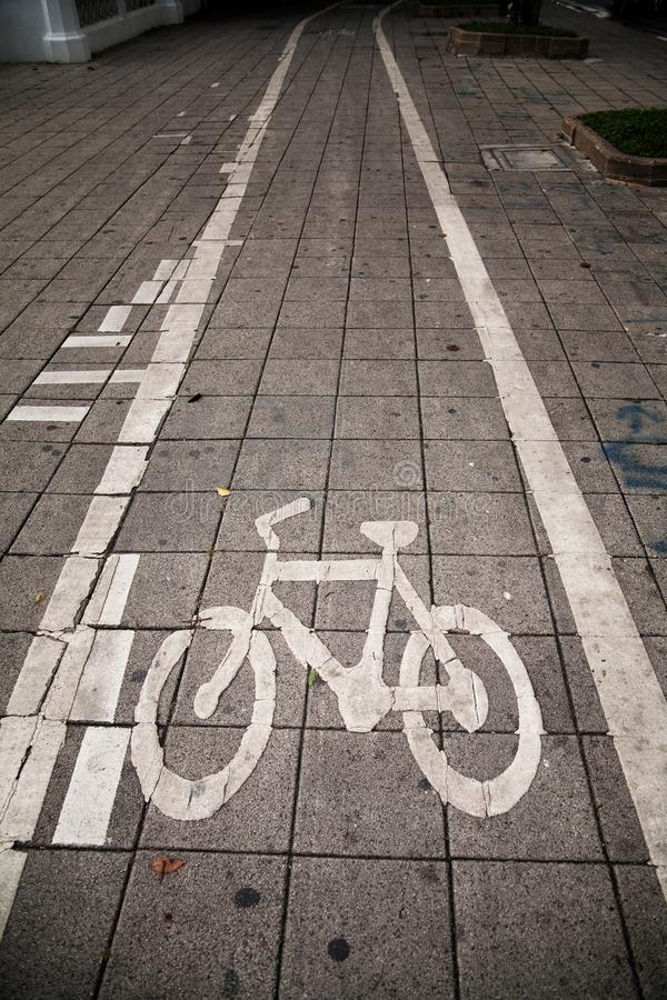 Bicycle path. The bike runs on a sidewalk in the city activities asphalt background bicycle bicycles biking direction environmentally exercise friendly lane royalty free stock photo
