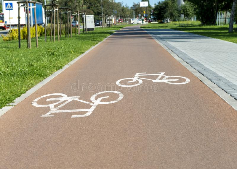 Bicycle path in the city. Bicycle path in the middle of the city. Bicycle signs on the path stock photo