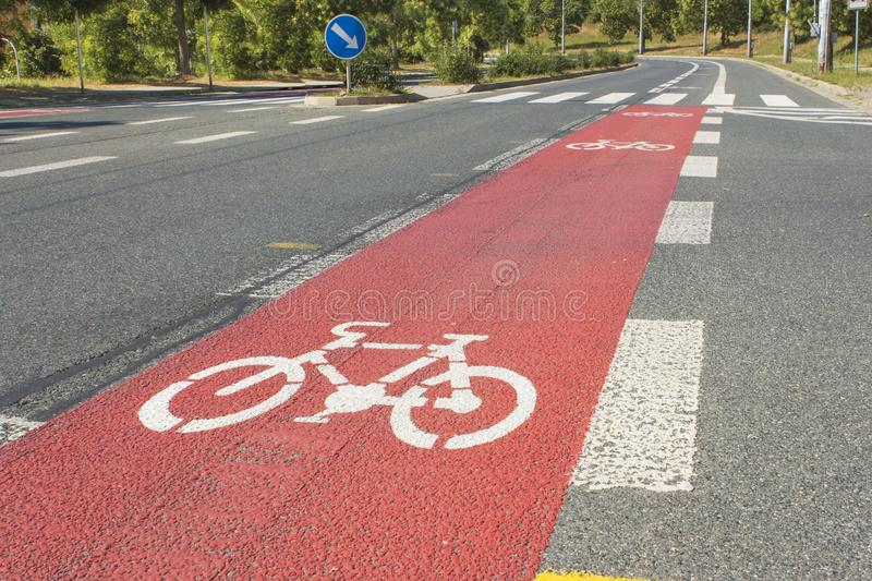 Bicycle path drawn on the asphalt road. Lanes for cyclists. Traffic signs and road safety. stock photos