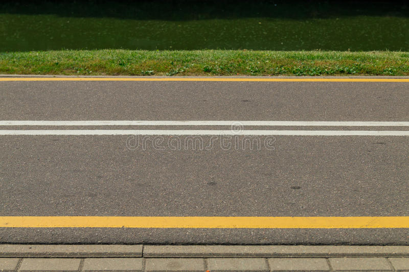 Bicycle path running along the canal bank stock photography