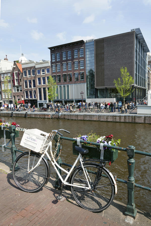 Bicycle on prinsengracht opposite anne frank house. In amsterdam royalty free stock photos