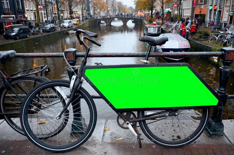 Bicycle Public Advertising. Public Bicycle parking Amsterdam, Netherlands. Bicycle Public Advertising. Public Bicycle parking Amsterdam, Netherlands royalty free stock photos