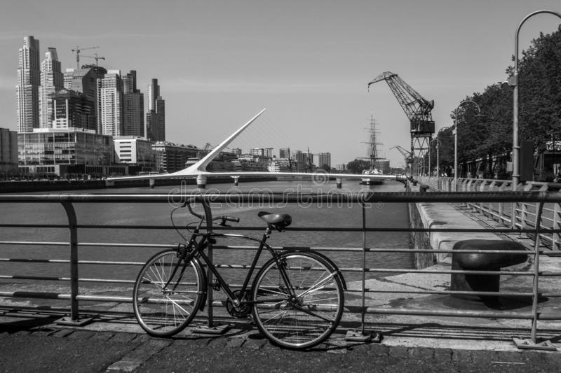 Bicycle in Puerto Madero in Buenos Aires and the Puente de la Mujer in the background stock photography