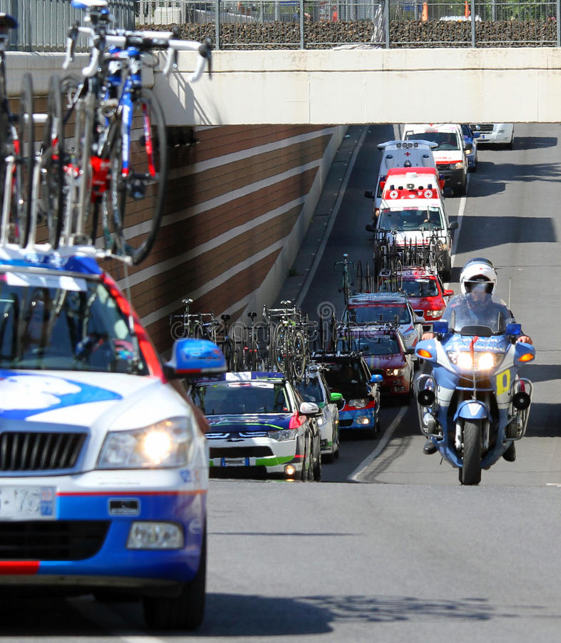 Bicycle race with the escort of cars and motorbikes. Of the police royalty free stock images