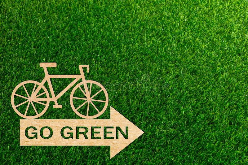 Bicycle race go green paper cut of a green background stock photos