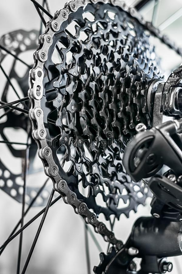 Bicycle rear wheel with detail of the gear system stock image
