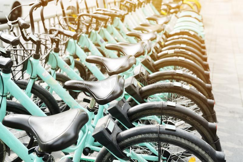 Bicycle rental service on city road parking royalty free stock photography