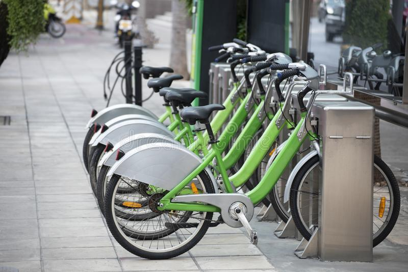 Bicycle rental station on public parking in the city.  stock photography