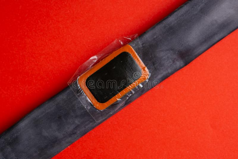 Bicycle repair kit, wheels camera on wooden background. Patch on the camera of the bike. Patch on the camera of the bike. bicycle repair kit, wheels camera on royalty free stock photography