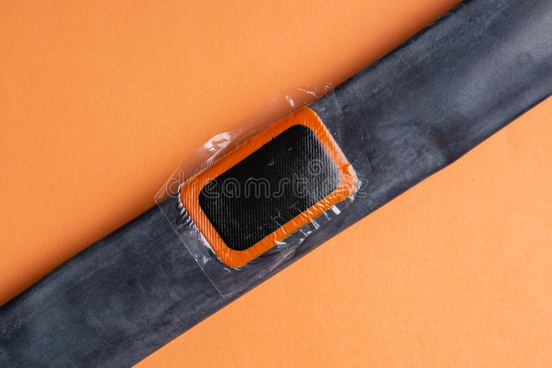 Bicycle repair kit, wheels camera on wooden background. Patch on the camera of the bike. Patch on the camera of the bike. bicycle repair kit, wheels camera on royalty free stock images