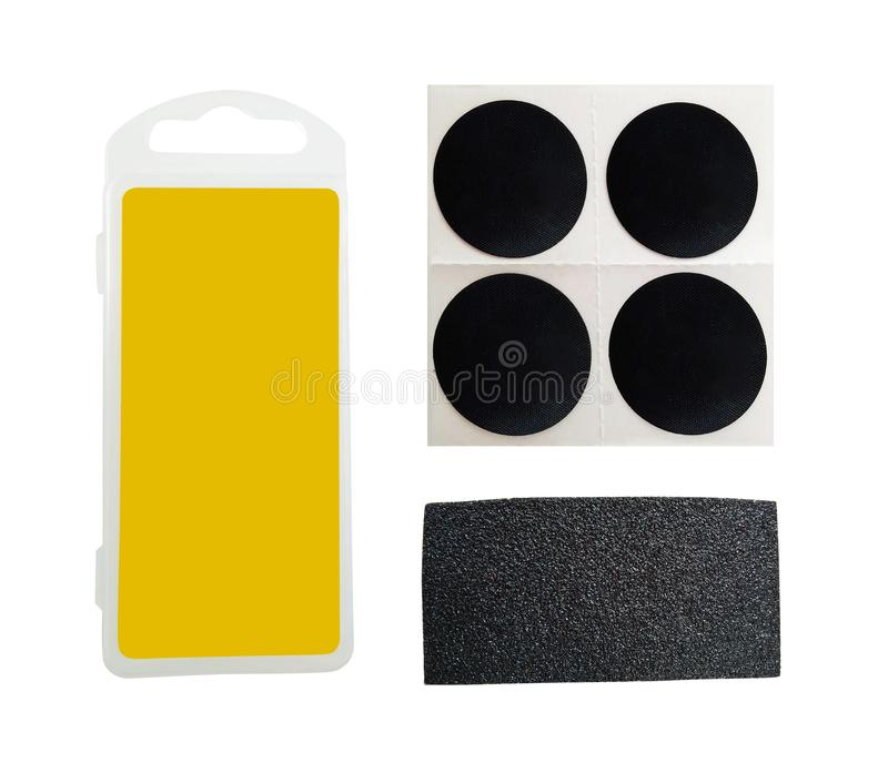 Bicycle repairing patches kit isolated. Set of box, patches and sand paper for bicycle tire repair. Bike accessories kit isolated on white background stock photos