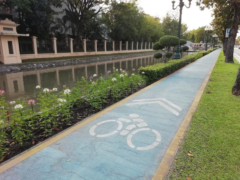 Bike lane is along the canal. royalty free stock photos