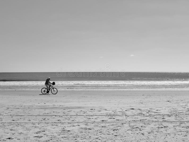 Bicycle Ride on Deserted Beach stock photos