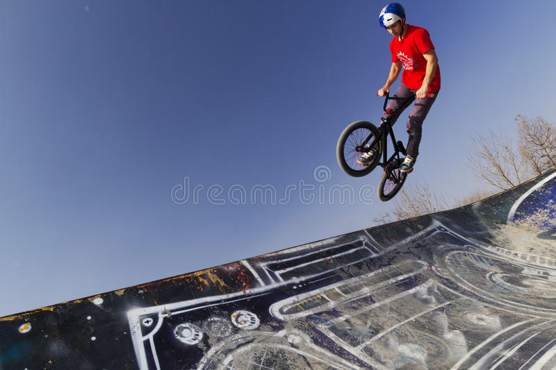 Young bmx bicycle rider. Bicycle rider in the air stock photos