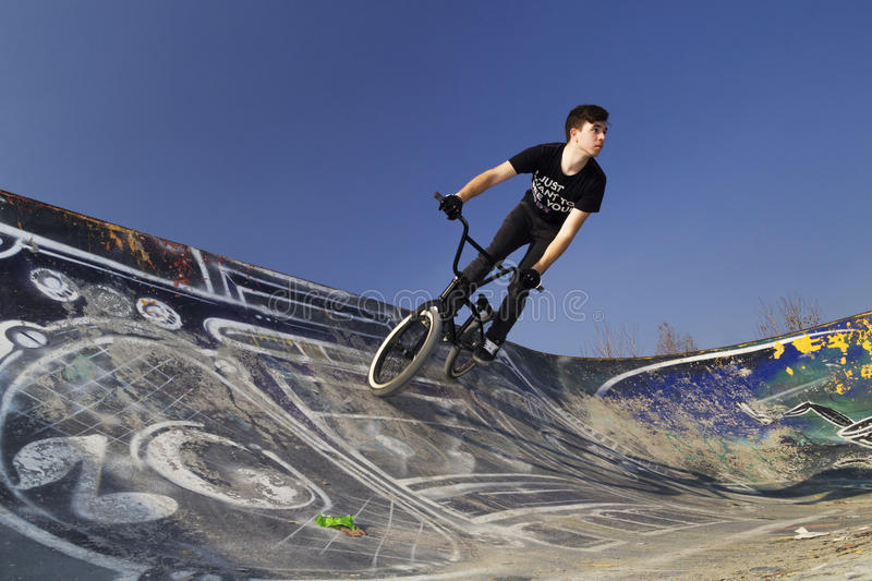 Young bmx bicycle rider. Bicycle rider in the air stock images