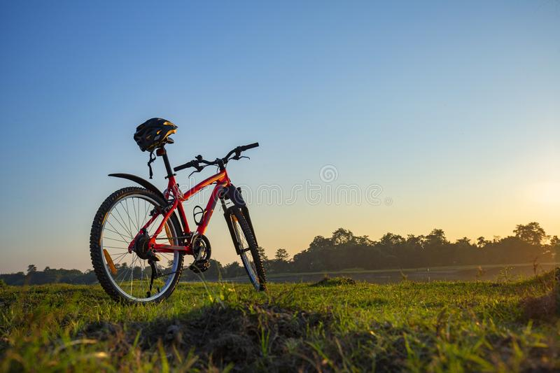 Bicycle with rider`s helmet , an evening day royalty free stock image
