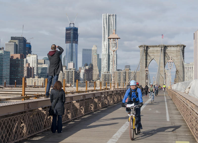 Bicycle Riders and Tourists enjoying a day on the Brooklyn Bridge. royalty free stock photo