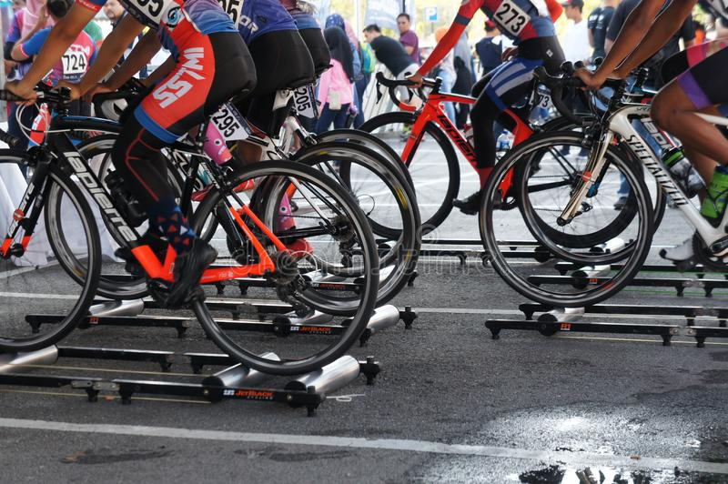 Bicycle riders are using the cycling roller trainer before the race begins. KUALA LUMPUR, MALAYSIA -APRIL 18, 2015: Bicycle riders are using the cycling roller stock images