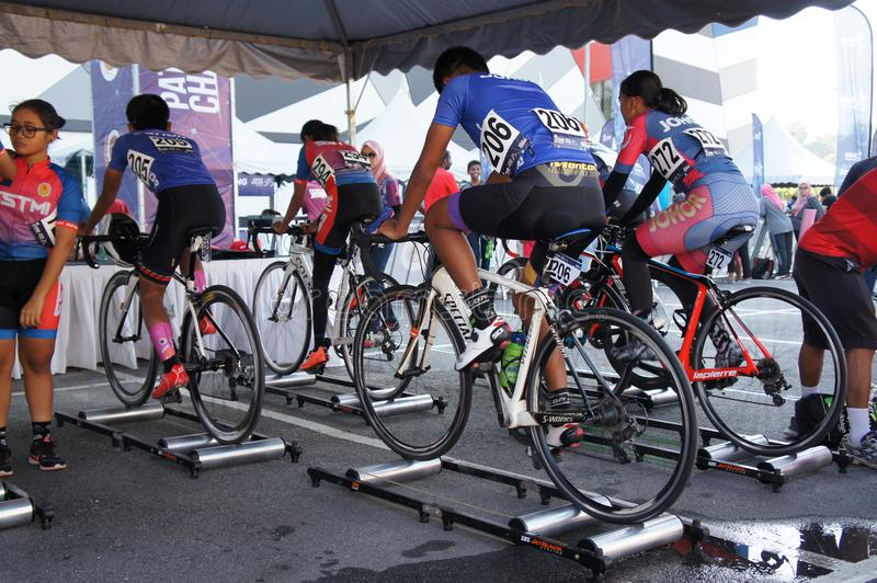 Bicycle riders are using the cycling roller trainer before the race begins. KUALA LUMPUR, MALAYSIA -APRIL 18, 2015: Bicycle riders are using the cycling roller stock image