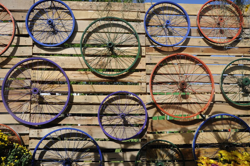 Bicycle rim various colors hung on the wall. PUTRAJAYA, MALAYSIA -MAY 30, 2016: Bicycle rim various colors hung on the wall as decoration royalty free stock photo
