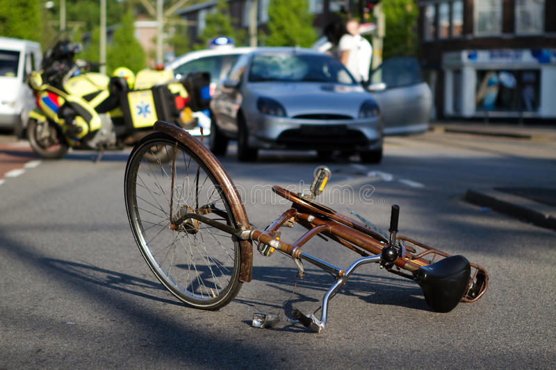 Bicycle road accident stock photo