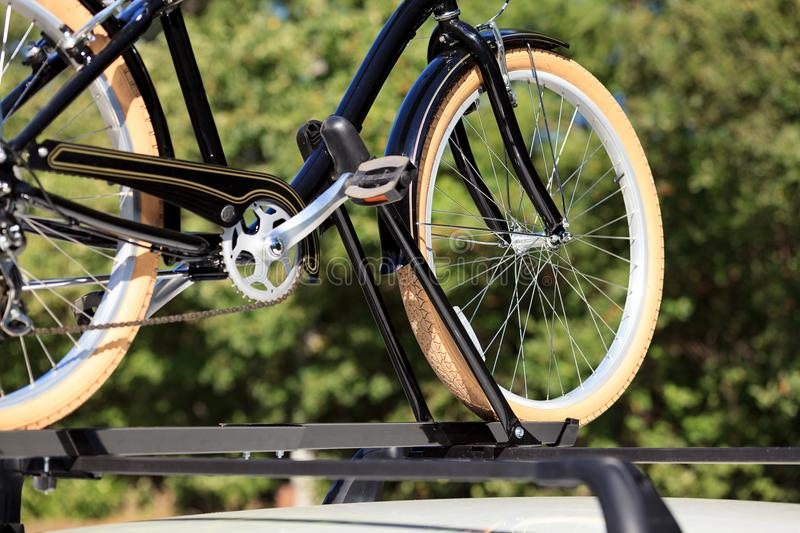 Bicycle on the roof of car royalty free stock photography