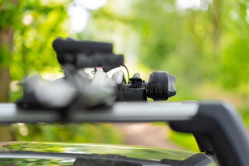 A bicycle roof rack on a car shown differently royalty free stock photo