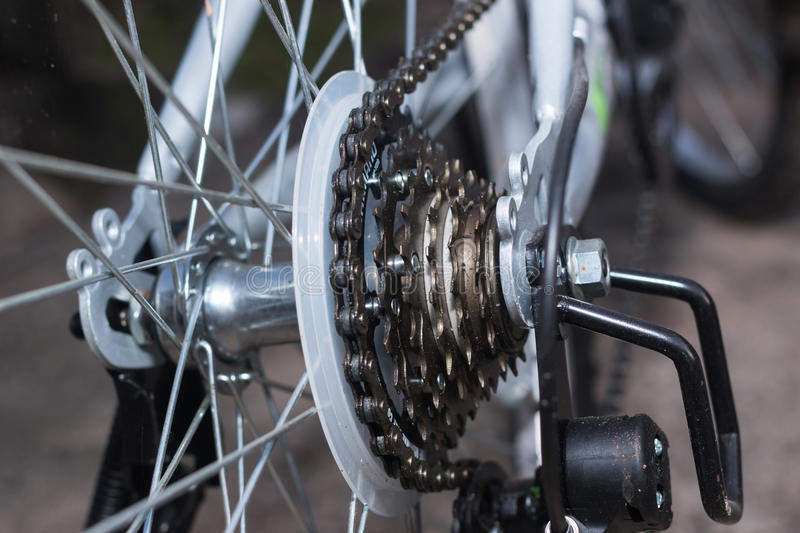 Bicycle's detail view of rear wheel with chain & sprocket royalty free stock photo