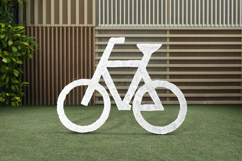 Bicycle sign, bike cycling on grass wooden wall background stock images