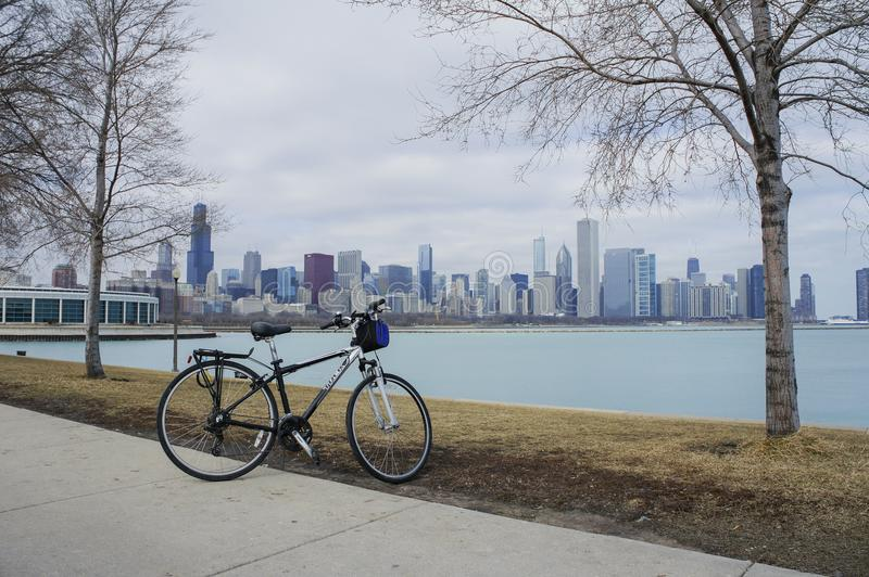 Bicycle, Skyscapers and skylin of Chicago and Lake Michigan from. Milennium Park at Illinois, United States royalty free stock image