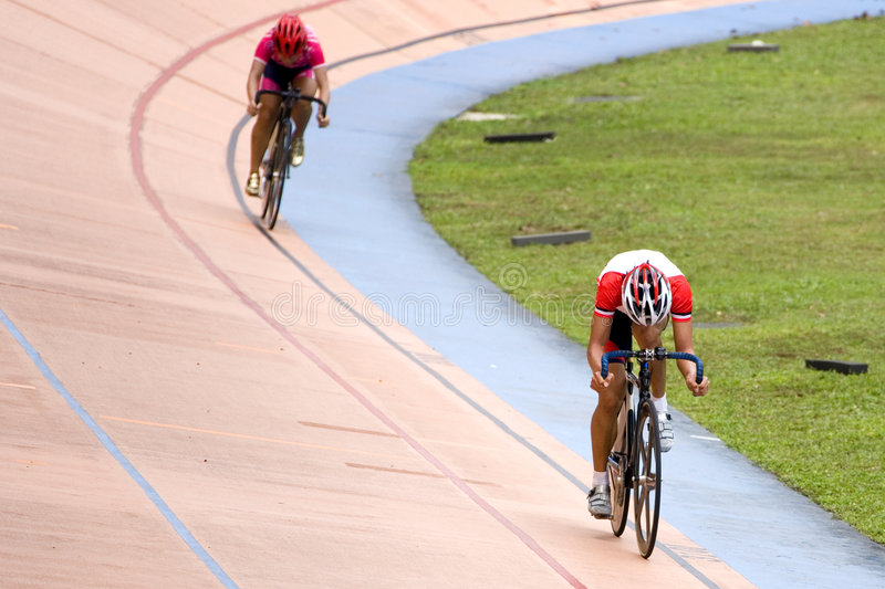 Bicycle Sprint Race. Image of participants in a cycling sprint race held at a velodrome royalty free stock photo