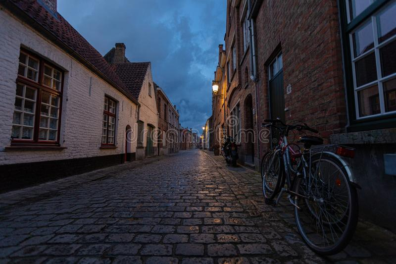 Bicycle stands near the wall of an old house in the historic city center of Brugge stock photo
