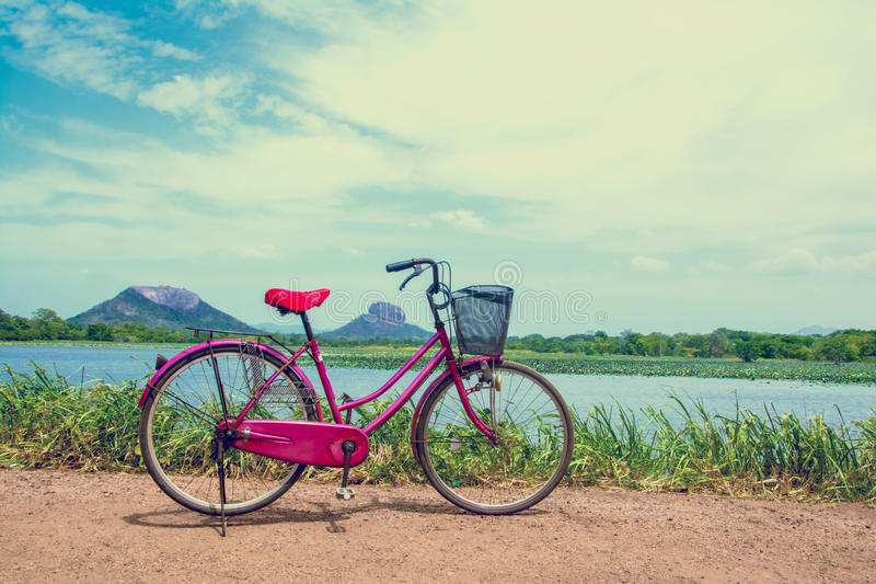 The bicycle stands on a village road at Thalkote lake near Sigiriya. Renting a bicycle and cycling around Sigiriya village is the most popular way among the royalty free stock image