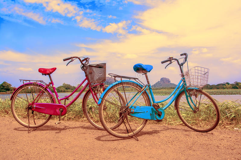 The bicycle stands on a village road at Thalkote lake near Sigiriya. Renting a bicycle and cycling around Sigiriya village is the most popular way among the royalty free stock photo