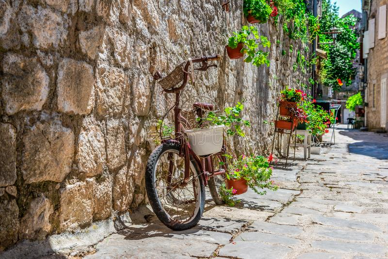 Bicycle on street in Perast stock photos