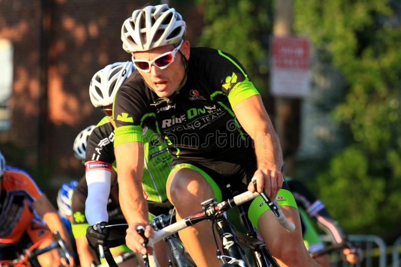 Bicycle street race event. Cyclist riders fight for the lead at the urban professional Criterium bicycle race in the city streets, USA Cycling event, northeast royalty free stock photo