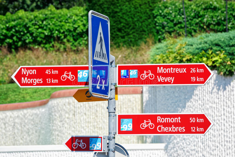 Bicycle street signs of cities in Lausanne. Switzerland royalty free stock images