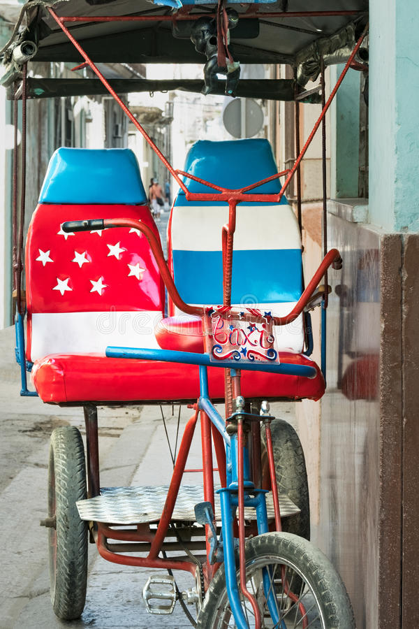 Bicycle taxi in Havana Cuba decorated with American flag. Bicycle taxi in Havana La Habana Cuba decorated with American flag royalty free stock photography