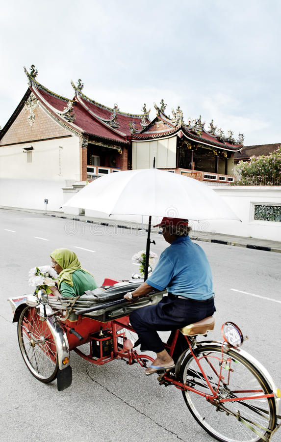 Bicycle taxi in penang malaysia stock photos