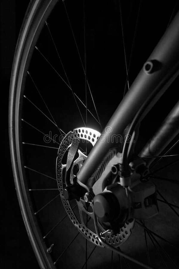 Bicycle tire, rim and spokes - shinny disc brakes royalty free stock image