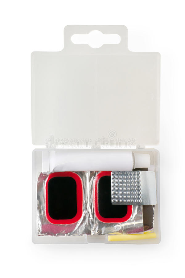 Bicycle tires repair kit in plastic box. Glue, patches and grate. R. Isolated on white, clipping path included royalty free stock image