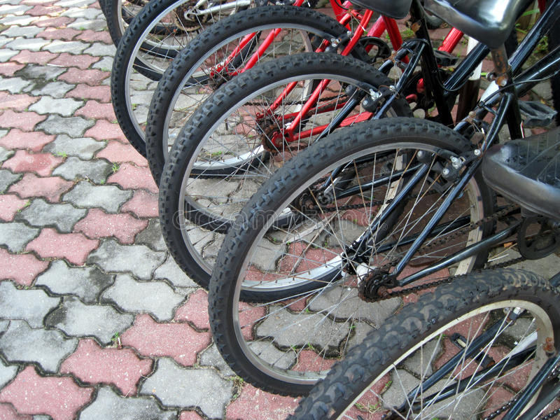 Bicycle transportation. A row of bicycle wheels showing transportation royalty free stock images