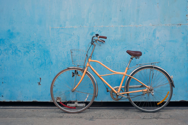 Bicycle. Vintage bicycle with old blue background stock photography
