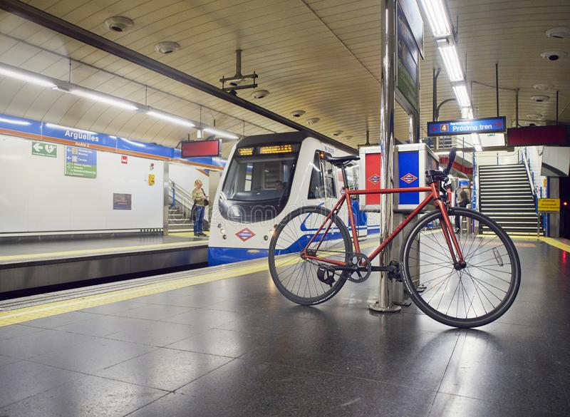 A bicycle waiting for a train in a Madrid Metro station. stock photography