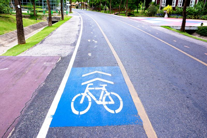 Bicycle and walk lane sign symbol on street in the public park stock photos